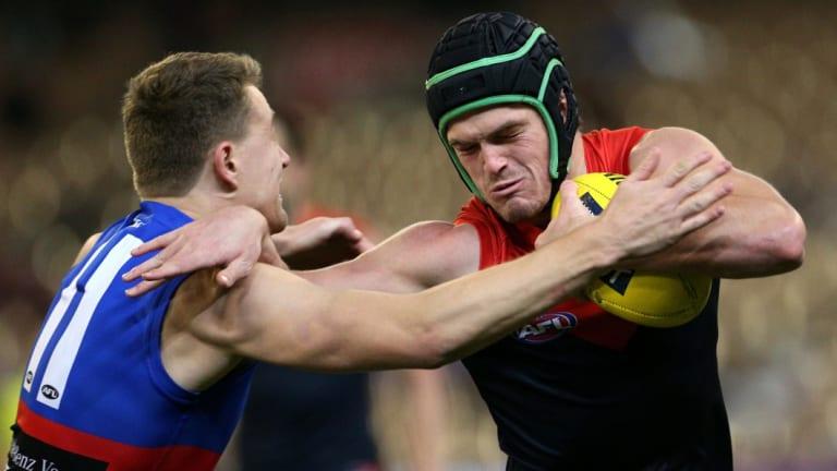 Angus Brayshaw tries to break a Macrae tackle.