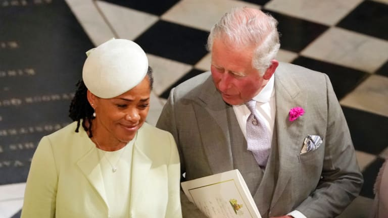 Britain's Prince Charles and Doria Ragland, mother of the bride, depart after the wedding ceremony of Prince Harry and Meghan Markle at St. George's Chapel in Windsor Castle in Windsor, on Saturday.