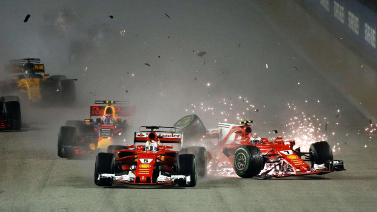 Sparks fly: Ferrari driver Kimi Raikkonen, right, collides with teammate Sebastian Vettel of Germany at the start of the 2017 Singapore Grand Prix on the Marina Bay City Circuit.