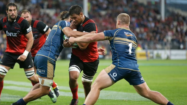 Crusaders Pete Samu attempts to bust a Brumbies tackle last year.