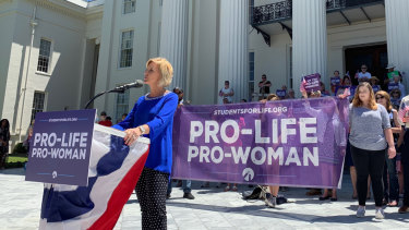 Beck Gerritson, president of Eagle Forum of Alabama, speaks at an anti-abortion rally outside the Capitol in Montgomery, Alabama.