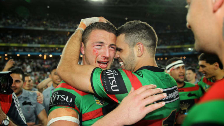 Magic man: Burgess cries as he embraces Greg Inglis following the Rabbitohs' drought-breaking grand final win in 2014.