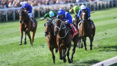 Super mare: Hugh Bowman rides Winx to victory in the Cox Plate ahead of Humidor in 2017.