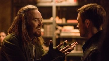 Tim Minchin, left, as Tuck and Taron Egerton, right, in Robin Hood.