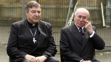 George Pell and John Howard in 2004. The former prime minister has provided a reference for Pell in the wake of his conviction for sexual assault.