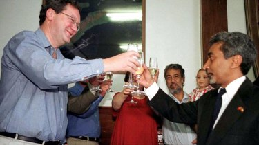 Before the storm: Alexander Downer toasts then economic affairs minister Mari Alkatiri in 2001 after signing a preliminary deal to split gas revenues from the Timor Sea.