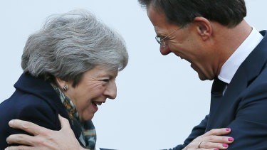 British Prime Minister Theresa May is greeted by Dutch Prime Minister Mark Rutte upon her arrival in The Hague, Netherlands, on  December 11.