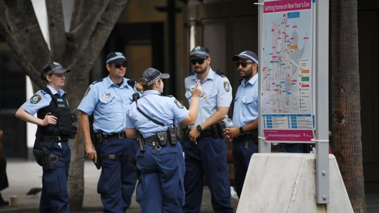 Police gather at Circular Quay on December 31, 2017.