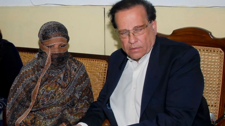 Salman Taseer, governor of Punjab Province, with Asia Bibi, at a prison in Sheikhupura near Lahore, in 2010. Taseer was shot dead in 2011 after speaking out against Pakistan's blasphemy laws.