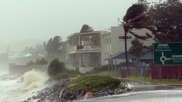 Insurers should offer insurance discounts to householders who make their homes. Pictured is Cyclone Marcia crossing the coast near Rockhampton.