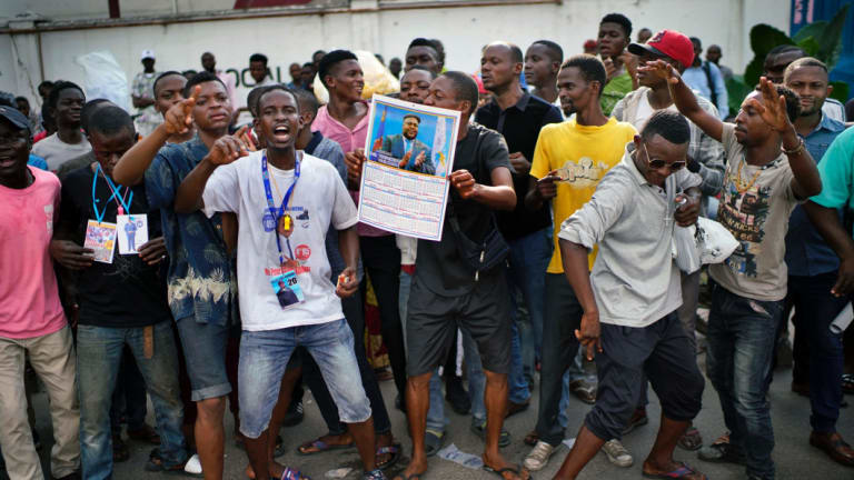 Supporters of Felix Tshisekedi outside the UDPS party headquarters in Kinshasa.