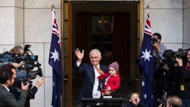 Outgoing prime minister Malcolm Turnbull with granddaughter Alice and grandson Jack after speaking to the media.
