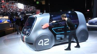 An employee dusts a VW Sedric concept electric autonomous robo-taxi ahead of the IAA Frankfurt Motor Show.