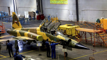 Technicians work on Kowsar domestically-built fighter jet production line at an undisclosed location, Iran.