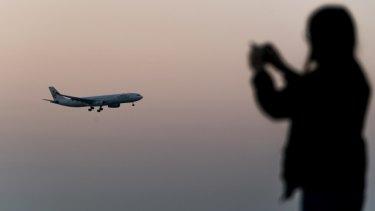A Cathay Dragon aircraft, operated by Cathay Pacific Airways, prepares to land at Hong Kong International Airport.
