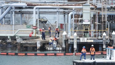 Workers at Viva's Gore Bay storage depot. after a spill in Sydney Harbour at the end of 2016.