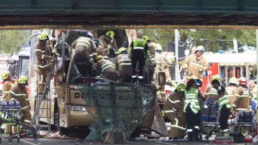 It took firefighters nearly an hour to free four people trapped inside the bus.