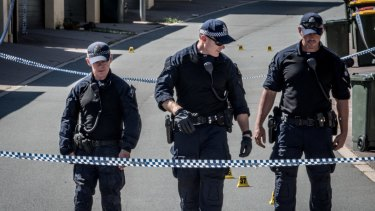 ACT police officers at the scene of the alleged murder in Gungahlin.