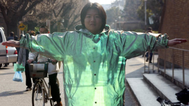 Graduate student Kazutoshi Obana demonstrates optical camouflage technology at Tokyo University in 2003.