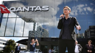 Sally McManus addresses Qantas employees at the airline's headquarters in Mascot in September, after workers' wage claims were frozen even as management took bonuses.