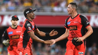 Job well done: Renegades Dwayne Bravo (left) and Chris Tremain celebrate after getting the better of Brisbane at the Gabba during last year's BBL season.