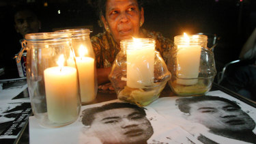Letchumi Murugesu, mother of Shanmugam Murugesu, who was hung for drug trafficking, attends a vigil held for Australian Ngyuen Tuong Van just hours before his execution in 2005.