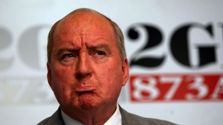 Broadcaster Alan Jones says he regrets using an 'old and offensive figure of speech'.