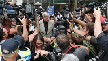 Cardinal George Pell leaves court on Tuesday afternoon, after the suppression order barring reporting of his conviction was lifted.