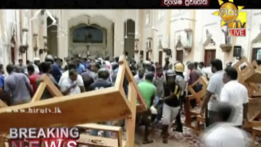 This image made from video provided by Hiru TV shows damage inside St Anthony's Shrine in Colombo.