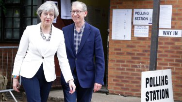 May leaves with her husband Philip after voting in the disastrous 2017 general election.