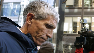 William 'Rick' Singer, founder of the Edge College & Career Network, departs federal court in Boston on Tuesday after pleading guilty.