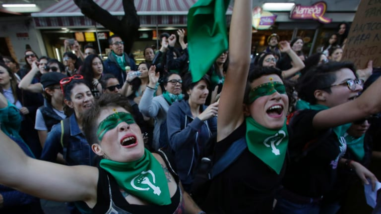 People shout in support of decriminalising abortion, outside the Argentinian embassy in Quito, Ecuador.