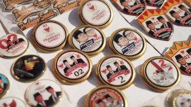 Buttons featuring images of presidential candidate Prabowo Subianto and his running mate Sandiaga Uno at a campaign rally in Karawang, West Java.