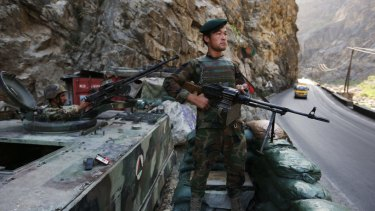 An Afghan soldier guards a checkpoint on the Kabul-Jalalabad highway on the outskirts of Kabul, Afghanistan.