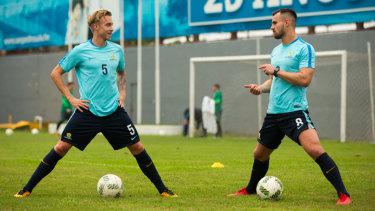 Hands off: Fringe Socceroo James Jeggo (left) in Honduras with Bailey Wright.