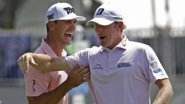 You beauty: Snedeker celebrates with playing partner Billy Horschel after making birdie on the final hole.