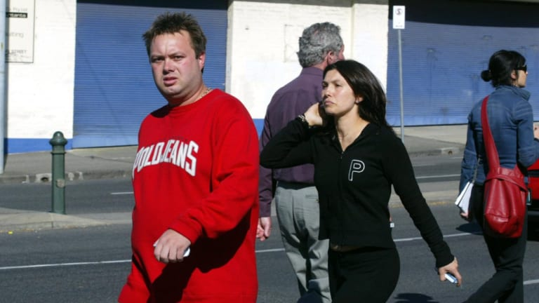 Carl Williams and former wife Roberta at the height of the gangland war in 2004.