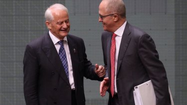Philip Ruddock, pictured here with Malcolm Turnbull in 2015, is pressuring Liberal electoral conferences to pick up their fundraising efforts.