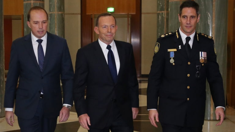 Then prime minister Tony Abbott and his immigration minister Peter Dutton at the swearing-in ceremony of inaugural Border Force commissioner Roman Quaedvlieg in 2015.