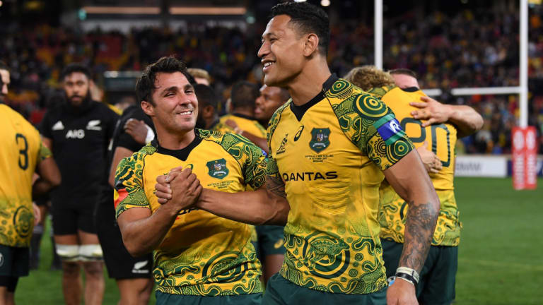 Nick Phipps and Israel Folau celebrate after the Wallabies win the third Bledisloe Cup Test in Brisbane.