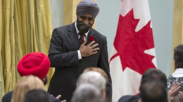 Sikh achievement: Harjit Singh Sajjan reacts after being sworn in as Canada's defence minister in Ottawa in 2015. Seated in the red turban is Navdeep Singh Bains, who was sworn in as science and innovation minister on the same day.