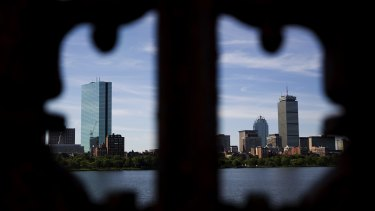 Buildings stand in the skyline of Boston, Massachusetts, U.S., on Tuesday, Aug. 7, 2012. Boston, a leading city for finance, has an economic base that includes research, manufacturing, and biotechnology. Photographer: Brent Lewin/Bloomberg