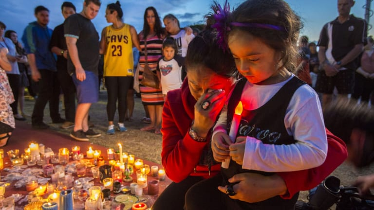 Mourners held a vigil outside Dreamworld after the tragedy.
