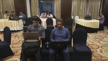 Journalists work inside a media centre set up by Jammu and Kashmir authorities in Srinagar, Indian controlled Kashmir.
