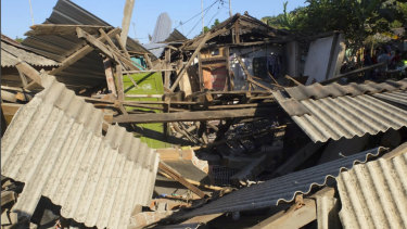 Houses damaged by an earthquake in North Lombok, Indonesia on Monday.