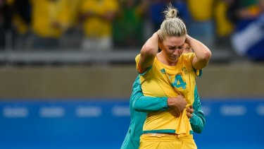 Heartbreak: Alanna Kennedy is comforted after missing the final penalty in the Matildas' loss to Brazil at the 2016 Rio Olympics.