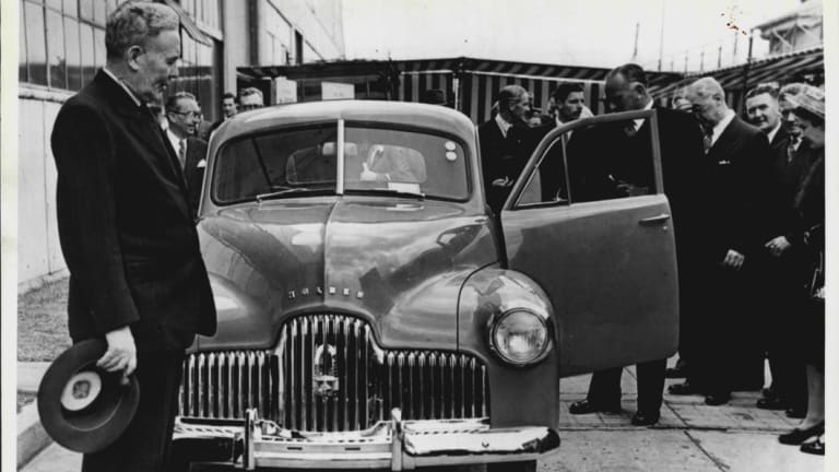 Ben Chifley with the first Holden in 1948.
