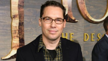 Bryan Singer has accused the magazine of 'rehashing false accusations' in a yet-to-be published article.