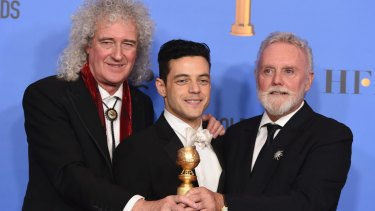 Brian May, left, and Roger Taylor, right, of Queen, and Rami Malek with the award for best motion picture, drama for Bohemian Rhapsody at last month's Golden Globes.
