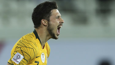 Australian forward Mathew Leckie celebrates after scoring the winning penalty.